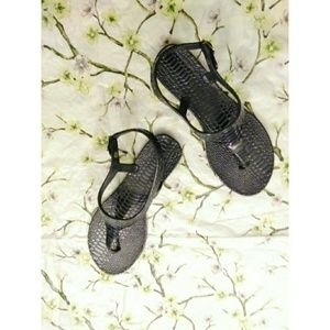 Xhiliration flat black sandals with deco design